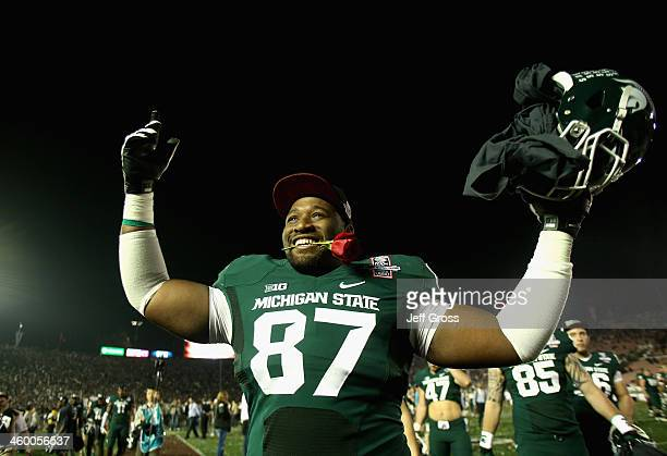 Defensive lineman Brandon Clemons of the Michigan State Spartans celebrates following their 2420 win over the Stanford Cardinal in the 100th Rose...