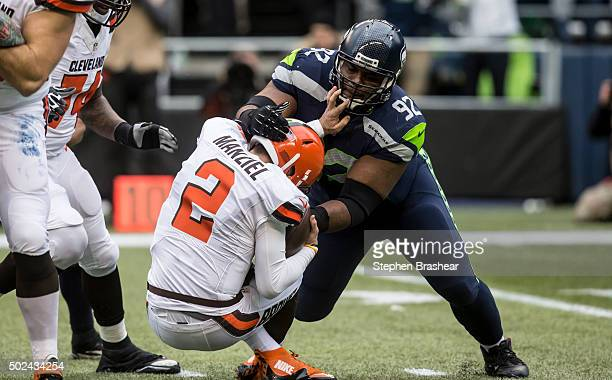 Defensive lineman Brandon Mebane of the Seattle Seahawks sacks quarterback Johnny Manziel of the Cleveland Browns during the first half of play at...