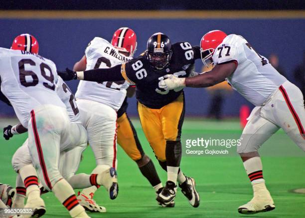 Defensive lineman Brentson Buckner of the Pittsburgh Steelers reaches for the ball carrier as he is blocked by offensive lineman Orlando Brown of the...