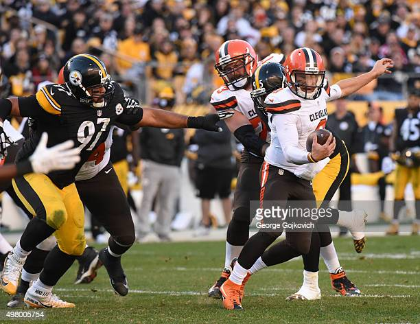 Defensive lineman Cameron Heyward of the Pittsburgh Steelers pursues quarterback Johnny Manziel of the Cleveland Browns as offensive lineman Joe...