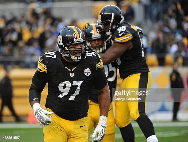 Defensive lineman Cameron Heyward of the Pittsburgh Steelers runs to the sideline as teammates Jarvis Jones and Vince Williams celebrate after...