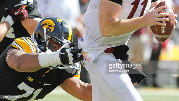 Defensive lineman Carl Davis of the Iowa Hawkeyes dives during the fourth quarter to get a hand on quarterback Max Shortell of the Minnesota Gophers...