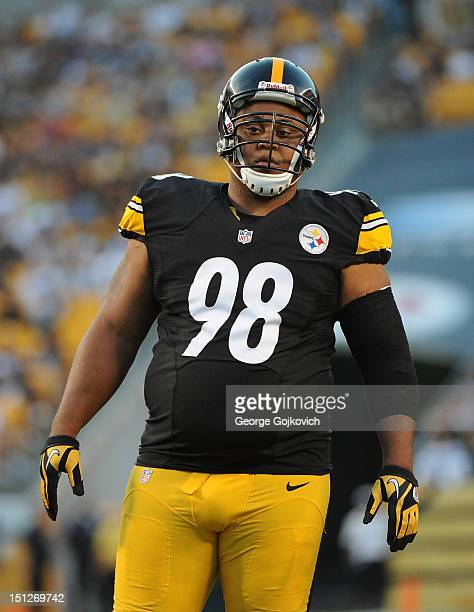 Defensive lineman Casey Hampton of the Pittsburgh Steelers looks on from the field during a preseason game against the Carolina Panthers at Heinz...
