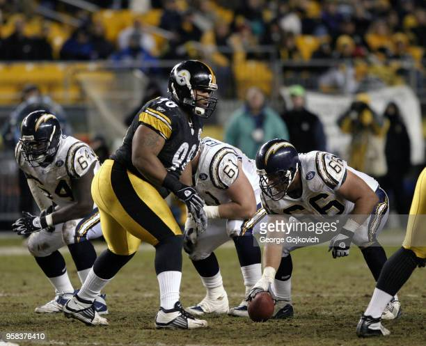 Defensive lineman Casey Hampton of the Pittsburgh Steelers looks across the line of scrimmage at offensive linemen Phil Bogle Michael Keathley and...