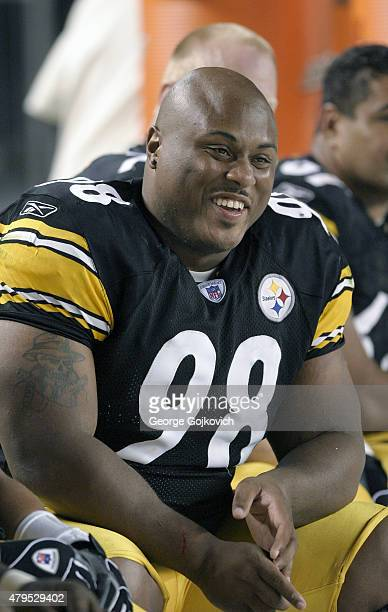 Defensive lineman Casey Hampton of the Pittsburgh Steelers smiles as he looks on from the sideline during a preseason game against the Philadelphia...