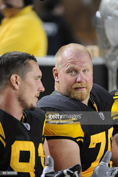 Defensive lineman Chris Hoke of the Pittsburgh Steelers sits on the sideline next to Aaron Smith during a game against the Baltimore Ravens at Heinz...