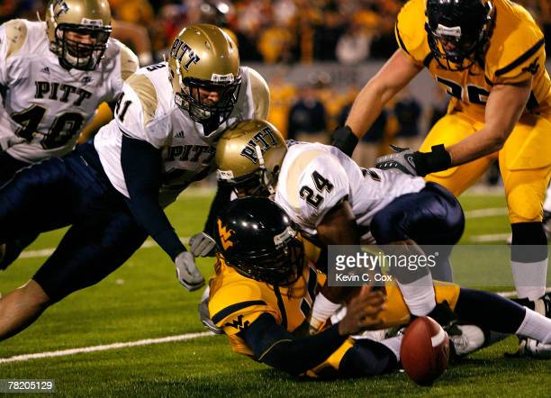 Defensive lineman Chris McKillop defends as linebacker Jemeel Brady of the Pittsburgh Panthers forces a fumble by backup quarterback Jarrett Brown of...