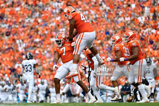 Defensive lineman Christian Wilkins jumps on defensive end Austin Bryant of the Clemson Tigers in celebration during the Tigers' football game...