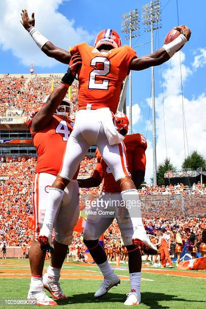 Defensive lineman Christian Wilkins of the Clemson Tigers lifts Quarterback Kelly Bryant in celebration after Bryant ran in a 35 yard touchdown in...