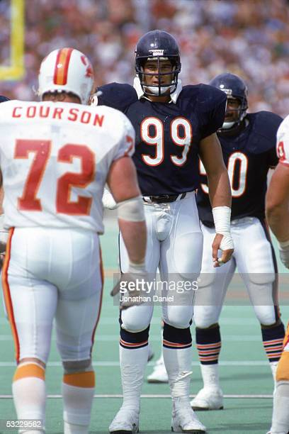 Defensive lineman Dan Hampton of the Chicago Bears eyes offensive lineman Steve Courson of the Tampa Bay Buccaneers as he walks to the line of...