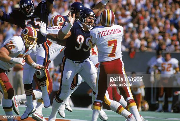 Defensive lineman Dan Hampton of the Chicago Bears gets through to quarterback Joe Theismann of the Washington Redskins during the game at Soldier...