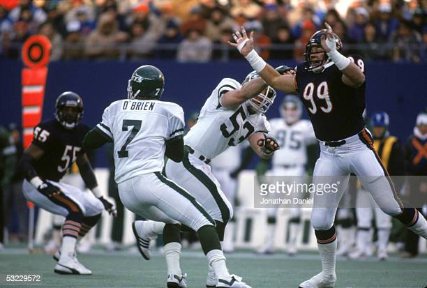 Defensive lineman Dan Hampton of the Chicago Bears goes after quarterback Ken O'Brien of the New York Jets during a game at Giants Stadium on...