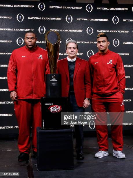 Defensive Lineman Da'Ron Payne Head Coach Nick Saban and Quarterback Tua Tagovailoa poses with the National Championship Trophy presented by Dr...