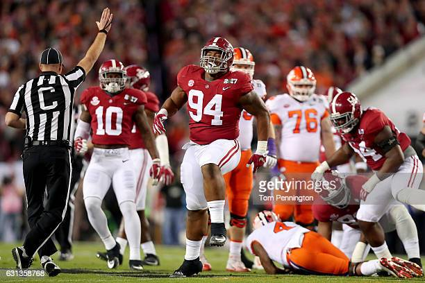 Defensive lineman Da'Ron Payne of the Alabama Crimson Tide celebrates after quarterback Deshaun Watson of the Clemson Tigers in the first quarter in...