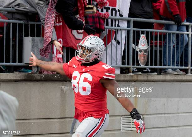 Defensive lineman Dre'Mont Jones of the Ohio State Buckeyes reacts to the fans as he leave leave the field after being ejected for a targeting call...