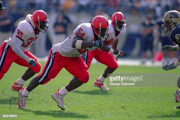 Defensive lineman Dwight Freeney of the Syracuse University Orange pursues the play during a college football game against the University of...
