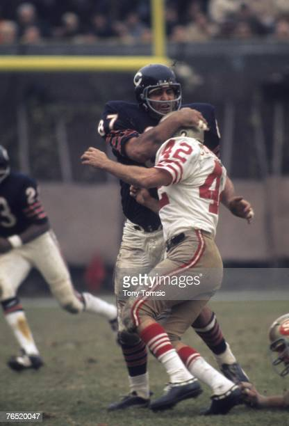 Defensive lineman Ed O'Bradovich of the Chicago Bears stops runningback Doug Cunningham of the San Francisco 49ers during a game on November 8 1970...