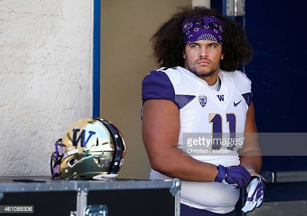 Defensive lineman Elijah Qualls of the Washington Huskies before the college football game against the Arizona Wildcats at Arizona Stadium on...