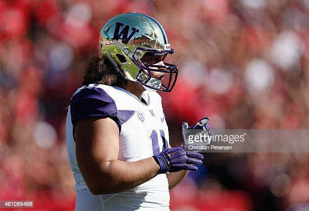 Defensive lineman Elijah Qualls of the Washington Huskies during the college football game against the Arizona Wildcats at Arizona Stadium on...
