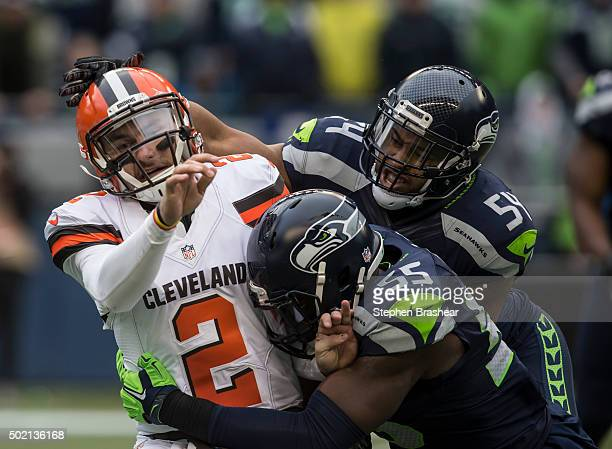 Defensive lineman Frank Clark of the Seattle Seahawks linebacker Bobby Wagner of the Seattle Seahawks hit quarterback Johnny Manziel of the Seattle...