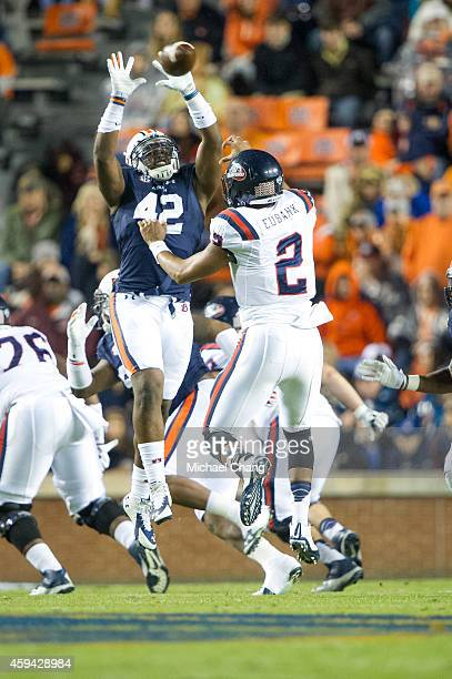 Defensive lineman Gimel President of the Auburn Tigers attempts to block a pass thrown by quarterback Michael Eubank of the Samford Bulldogs on...