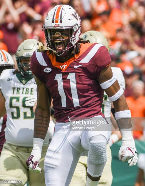 Defensive lineman Houshun Gaines of the Virginia Tech Hokies reacts following his forced fumble against the William Mary Tribe in the first half at...