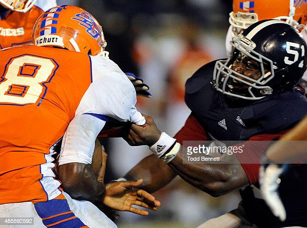 Defensive lineman Jamal Johnson of the Georgia Southern Eagles makes the grab on quarterback KerSean Wilson of the Savannah State Tigers on September...