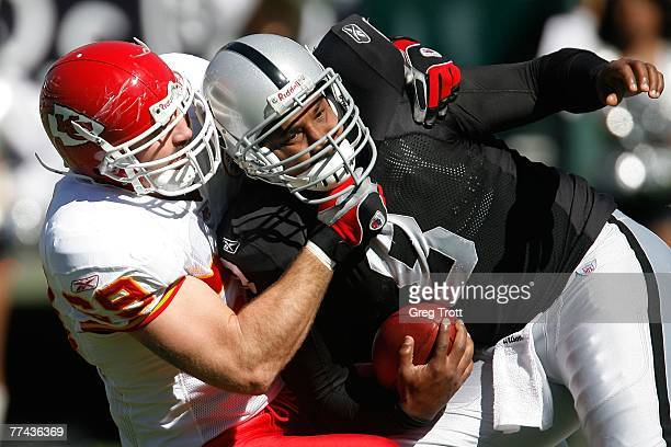 Defensive lineman Jared Allen of the Kansas City Chiefs sacks quarterback Daunte Culpepper of the Oakland Raiders during a game against the Kansas...