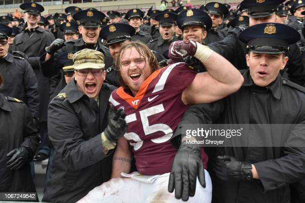 Defensive lineman Jarrod Hewitt of the Virginia Tech Hokies celebrates with the Corps of Cadets following the victory against the Marshall Thundering...