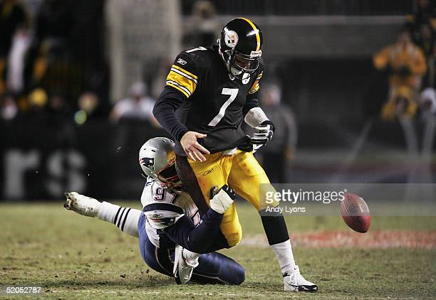Defensive lineman Jarvis Green of the New England Patriots hits and causes quarterback Ben Roethlisberger of the Pittsburgh Steelers to fumble in the...
