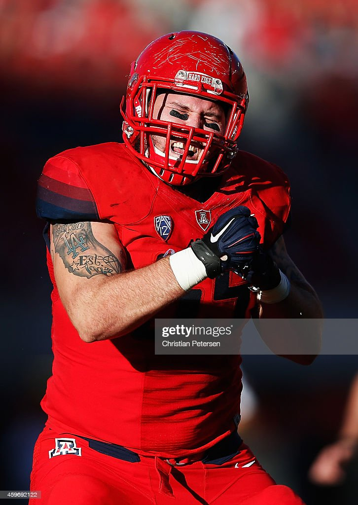 Defensive lineman Jeff Worthy #55 of the Arizona Wildcats celebrates after a tackle in the back field during the Territorial Cup college football game against the Arizona State Sun Devils in the third quarter at Arizona Stadium on November 28, 2014 in Tucson, Arizona.