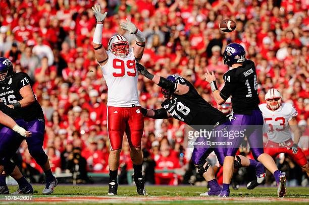 Defensive lineman JJ Watt of the Wisconsin Badgers defends a pass by quarterback Andy Dalton of the TCU Horned Frogs during the 97th Rose Bowl game...
