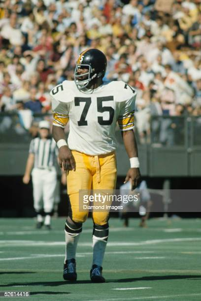Defensive lineman Joe Greene of the Pittsburgh Steelers awaits the next play during a game on October 14 1973 against the Cincinnati Bengals at...