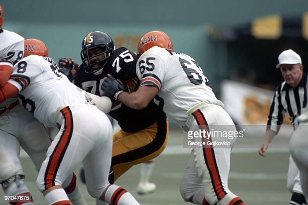 Defensive lineman Joe Greene of the Pittsburgh Steelers fights off a block by offensive lineman Max Montoya of the Cincinnati Bengals during a game...