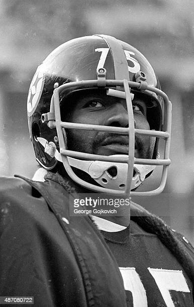 Defensive lineman Joe Greene of the Pittsburgh Steelers looks on from the sideline during a game against the Cincinnati Bengals at Three Rivers...