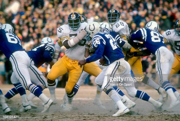 Defensive lineman Joe Greene of the Pittsburgh Steelers pursues running back Lydell Mitchell of the Baltimore Colts December 19 1976 during an NFL...