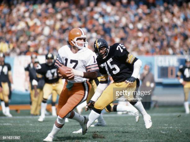 Defensive lineman Joe Greene of the Pittsburgh Steelers pursues quarterback Brian Sipe of the Cleveland Browns during a game at Cleveland Municipal...