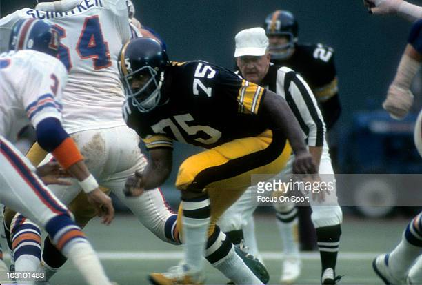 Defensive lineman Joe Greene of the Pittsburgh Steelers pursuing the play against the Denver Broncos circa 1973 during an NFL football game at Three...