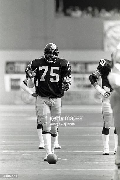 Defensive lineman Joe Greene of the Pittsburgh Steelers smiles as he looks across the line of scrimmage at the Cleveland Browns during a National...