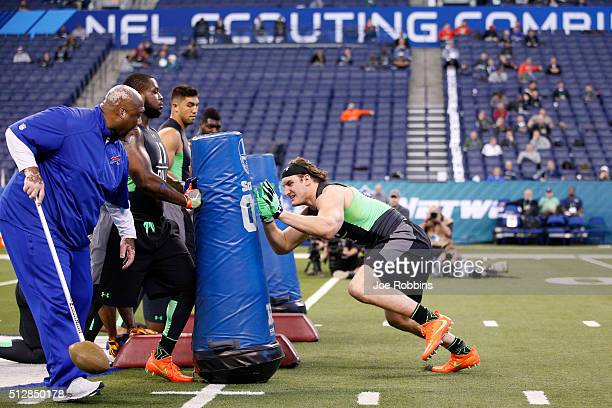 Defensive lineman Joey Bosa of Ohio State participates in a drill during the 2016 NFL Scouting Combine at Lucas Oil Stadium on February 28 2016 in...