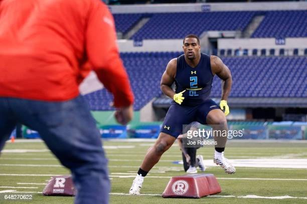 Defensive lineman Jonathan Allen of Alabama participates in a drill during day five of the NFL Combine at Lucas Oil Stadium on March 5 2017 in...