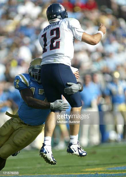 Defensive lineman Justin Hickman of UCLA pressures quarterback Kris Heavner of the University of Arizona during the first quarter of the 3717 win...