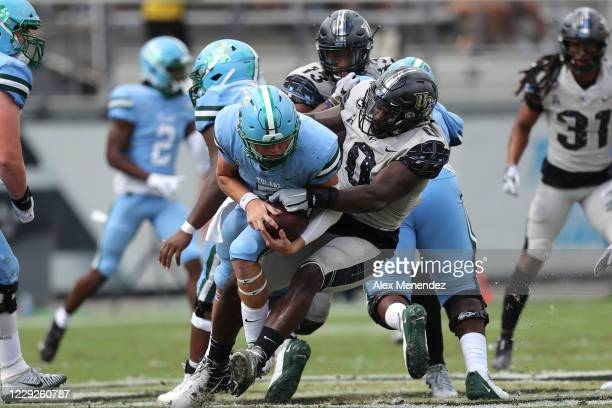 Defensive lineman Kenny Turnier of the Central Florida Knights sacks quarterback Michael Pratt of the Tulane Green Wave during the first half at...