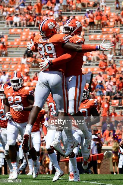 Defensive lineman KJ Henry of the Clemson Tigers celebrates with defensive end Clelin Ferrell after the Tigers force a Furman Paladins fumble during...