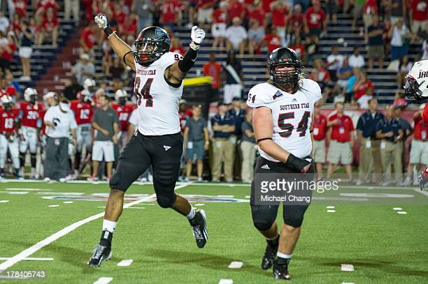 Defensive lineman Kouri Jones and offensive guard Nick Nissen of the Southern Utah Thunderbirds celebrate after defeating the South Alabama Jaguars...