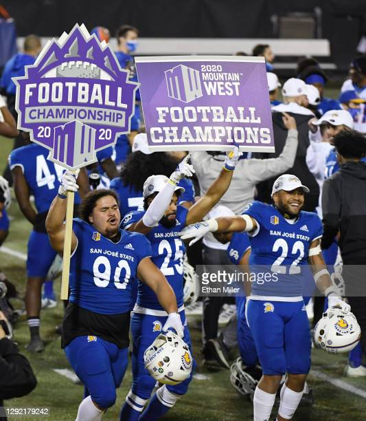 Defensive lineman Lando Grey, cornerback Charlie Bostic III and safety Tre Jenkins of the San Jose State Spartans celebrate on the field after the...