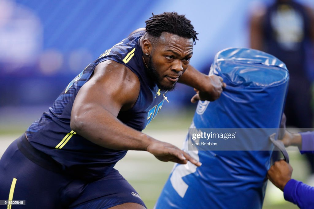 Defensive lineman Larry Ogunjobi of Charlotte participates in a drill during day five of the NFL Combine at Lucas Oil Stadium on March 5, 2017 in Indianapolis, Indiana.