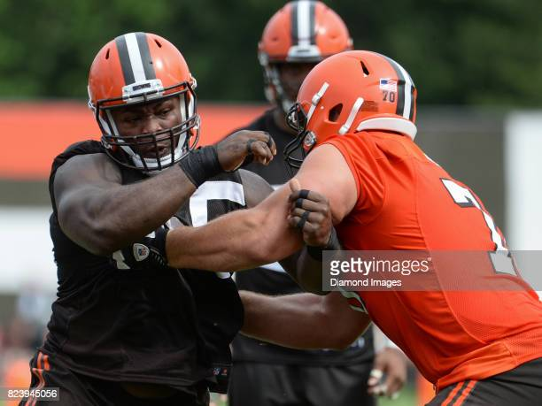 Defensive lineman Larry Ogunjobi of the Cleveland Browns engages guard Kevin Zeitler during a training camp practice on July 27 2017 at the Cleveland...