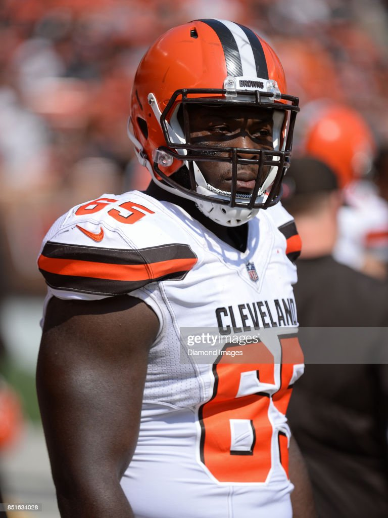 f6c6b58e6 ... Defensive lineman Larry Ogunjobi 65 of the Cleveland Browns stands on  the sideline prior to ...