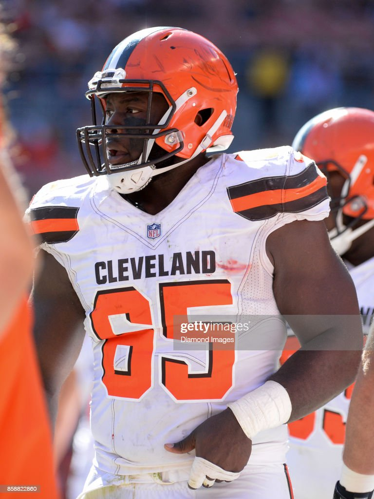 55f4ce441 ... Defensive lineman Larry Ogunjobi 65 of the Cleveland Browns walks along  the sideline in the 65 Nike Larry Ogunjobi Womens Brown NFL Jersey - Name  Number ...
